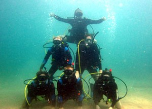Photo of our staff on a scuba dive having fun at work.